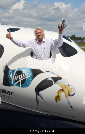 Sir Richard Branson, Founder of Virgin Galactic, with a model of LauncherOne in a replica of SpaceShipTwo. - Stock Photo