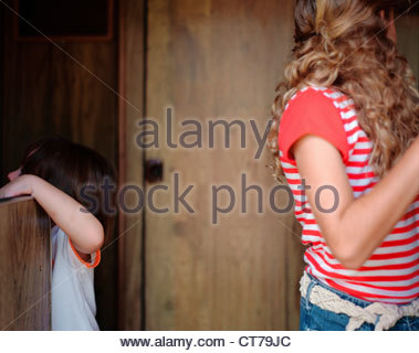 Two sisters playing in camper van - Stock Photo