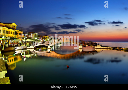 Sunset at Lefkas (Lefkada)  town, at the small marina for the fishing boats with the nice wooden bridge. Ionian - Stock Photo