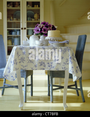 Rustic style table with tea and cake - Stock Photo