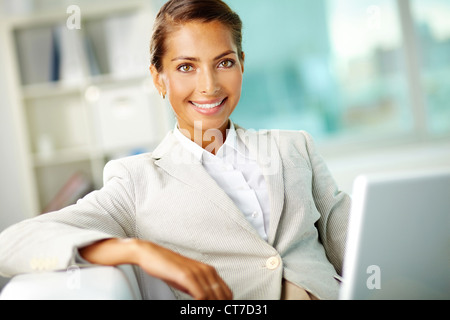 Smiling businesswoman representing positive attitude and success in business - Stock Photo