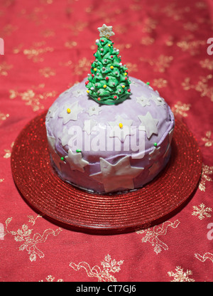 Italian home made marzipan decorated Christmas panettone cake laying on table - Stock Photo