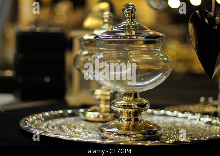 bowl from glass with gold shining metal parts - Stock Photo