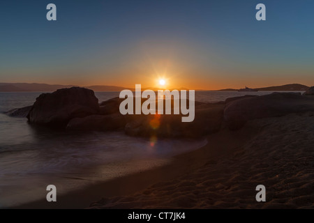 Sunset on the beach of Maragas, Naxos, Greece, with a view to Paros - Stock Photo