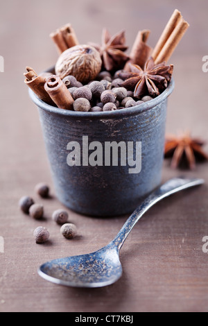 rustic setting with dried spices - Stock Photo