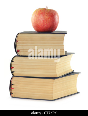 Composition with stack of books and apple isolated on white - Stock Photo