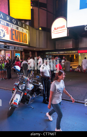 NYPD Police officer next to his Harley Davidson Motorbike in Times Square, Manhattan, New York City - Stock Photo