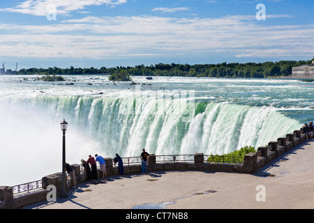 Tourists viewing the Horseshoe Falls from the Canadian side, Niagara Falls , Ontario, Canada - Stock Photo