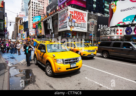 The iconic yellow taxi taxis cab in Times Square, New York city USA. Times square new York,times square,times square - Stock Photo