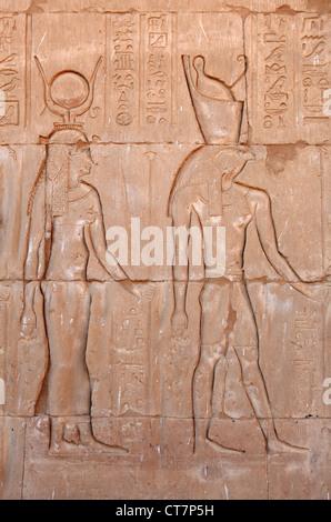 Inscriptions on the main entrance of Horus temple in Edfu, Egypt - Stock Photo