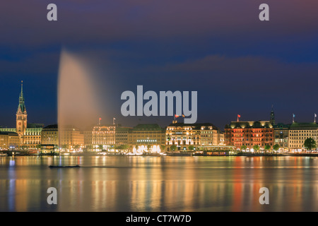 Hamburg skyline taken right after sunset at the blue hour over the binnenalster. - Stock Photo