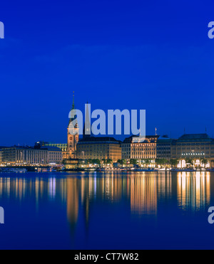 Hamburg skyline taken right after sunset at the blue hour over the binnen Alster. - Stock Photo