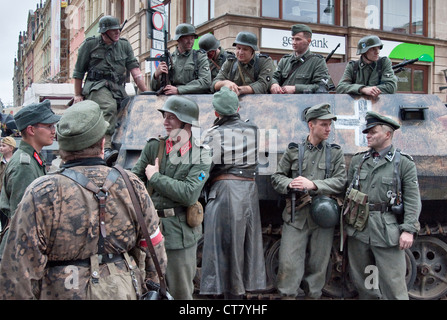 Re-enactors, SPW SdKfz 250 German armored personnel carrier, displayed after 1944 Warsaw Uprising re-enactment in - Stock Photo