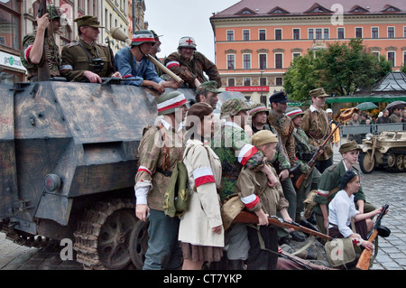 Home Army troops re-enactors posing for pictures after 1944 Warsaw Uprising re-enactment in Wroclaw, Poland - Stock Photo