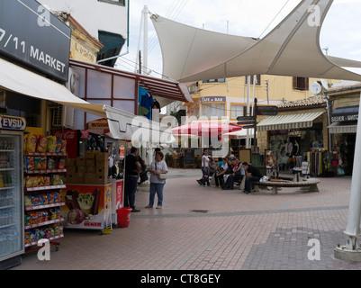 dh Old Town North NICOSIA CYPRUS Turkish girls sitting public area Lefkosa street square - Stock Photo