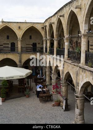 dh Old Town North NICOSIA CYPRUS Cafe table Buyuk Han Big Inn courtyard Lefkosa Ottomans Caravanserai - Stock Photo