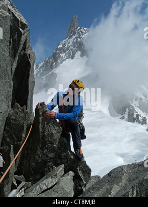 Climbers on the Aiguilles Marbrees in the French Alps - Stock Photo