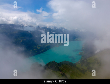 Lake Brienz (Brienzersee) from Brienzer Rothorn View through clouds over lake Bernese Oberland Switzerland Europe - Stock Photo