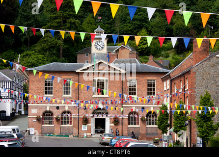 Montgomery Town Hall and clock tower and Broad Street with bunting Montgomery Powys Mid Wales UK - Stock Photo
