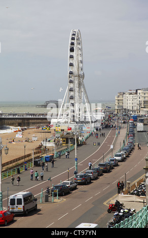 Brighton Wheel on seafront on Madeira Drive near Palace Pier - Stock Photo