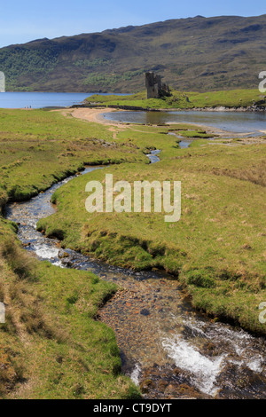 Small stream and Ardvreck castle ruins on shore of Loch Assynt in Scottish northwest highlands in Sutherland Scotland - Stock Photo