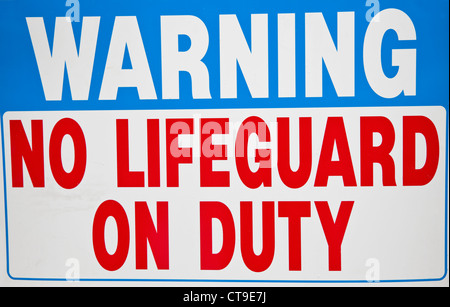 No Lifequard on duty sign - Stock Photo