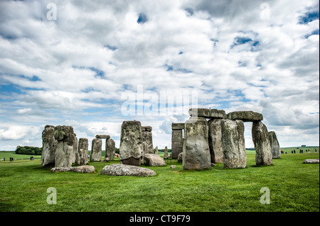 STONEHENGE, UK - LONDON, UK - Stonehenge with Partly Cloudy Sky. Believed to have been built somewhere between 2000 - Stock Photo