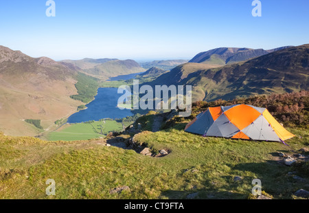 2-man tent pitched at the top of the ridge leading to the summit of Fleetwith Pike in the Lake district - Stock Photo
