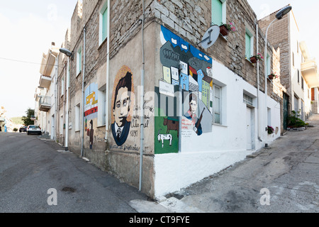 Murals with political issues in the village Orgosolo on Sardinia, Italy - Stock Photo