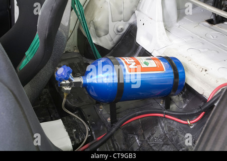 Nitrous oxide funny or laughing gas used to produce extra horsepower in a boy racer style modified custom race car. - Stock Photo