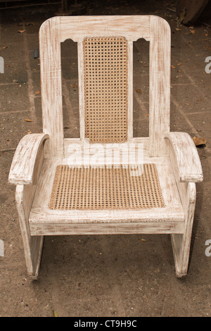 old wooden caned chair restored and repainted. - Stock Photo