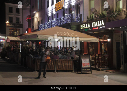 Bella Italia Restaurant Leicester Square London at night - Stock Photo