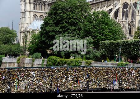 Love padlock on Pont de l'Archeveche bridge on the Seine river,Paris,France,Notre-Dame de Paris Cathedral - Stock Photo