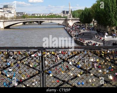 Love padlock on Pont de l'Archeveche bridge on the Seine river,Paris,France,Sainte Genevieve bridge - Stock Photo
