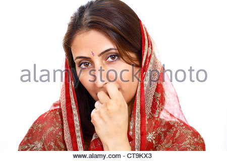 Thoughtful indian woman - Stock Photo