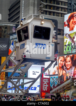 Police monitor activity in Times Square, New York City, from a mobile guard tower. The site of an attempted terrorist - Stock Photo