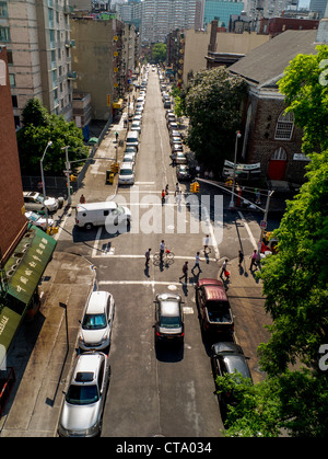 Traffic and pedestrians on a summer afternoon Madison Street in Lower Manhattan, New York City. - Stock Photo