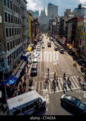 Traffic and pedestrians on a summer afternoon on East Broadway in Lower Manhattan, New York City. - Stock Photo