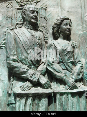Relief of King Juan Carlos of Spain and his wife, Queen Sofia, on cathedral door in Madrid, Spain - Stock Photo