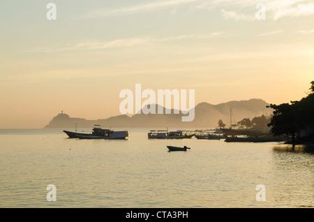 dili coastline with fishing boats in east timor, timor leste - Stock Photo