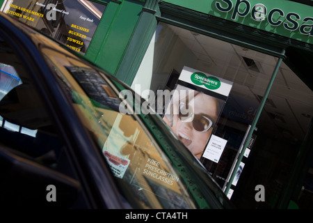 Specsavers shop front and reflections in car windscreen - Stock Photo