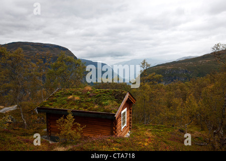 Wooden hut with a moss covered roof in a rocky landscape, close to Eidfjord, Hordaland, Norway, Skandinavia, Europe - Stock Photo