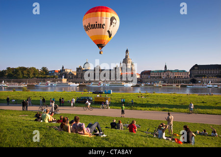 Balloons rising from the Elbe riverbank, Bruehlsche Terrasse and Frauenkirche in the background, Dresden, Saxonia, - Stock Photo