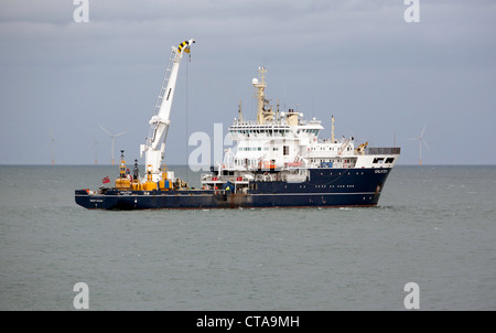 THV Galatea services a buoy off Rhos On Sea, North Wales - Stock Photo
