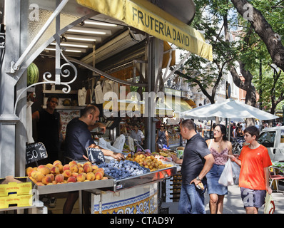 People at fruit stall in front of Central market hall Mercado Central, Valencia, Spain, Europe - Stock Photo