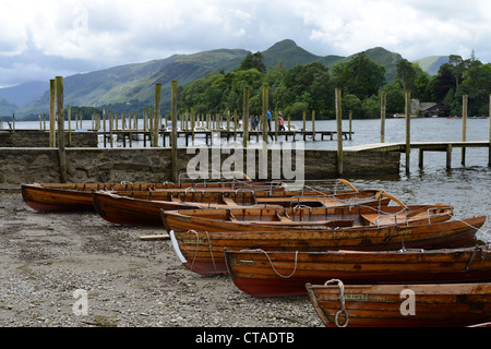 Rowing boats on the shore of Derwent Water at Keswick, Lake District National Park, Cumbria, UK - Stock Photo