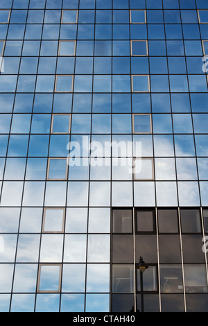 Blue sky and clouds reflected in office block glass windows. Inmarsat conference building. Old street. London - Stock Photo