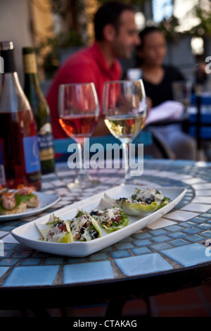 Chicory Leaves filled with baby cos lettuce, black olives, walnuts and gorgonzola dressing, Restaurant Fork, Cape - Stock Photo