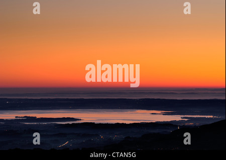 Pre alps with lake Chiemsee at dawn, view from Wendelstein range, Bavarian alps, Upper Bavaria, Bavaria, Germany, - Stock Photo