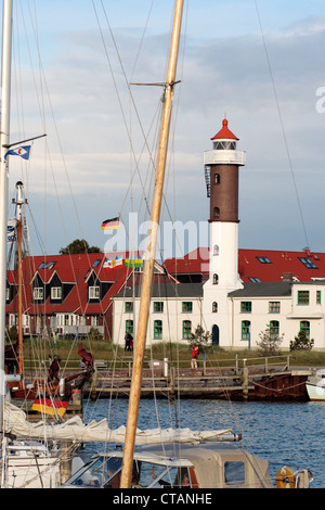 Timmendorf in on the island of Poel, the lighthouse with harbor front - Stock Photo